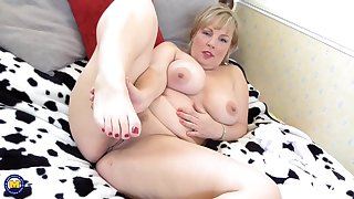 Buxom British mature amateur BBW Danielle spreads her shaved pussy